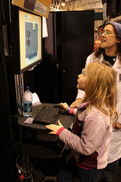 Little girl plays Symon at PAX